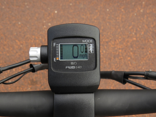The aluminum cased display on the A2B Alva + is mounted front and center on the industrial looking stem.  At the display you can adjust the pedal assist levels (Economy, Standard, or High), and check the battery level, speed, trip distance, overall odometer, etc.