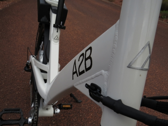 The Alva + step thru aluminum frame uses box section tubing and gussets to give it a unique look and solid ride.  Note the internal cable routing in the headtube gusset to keep the looks of the bike clean.