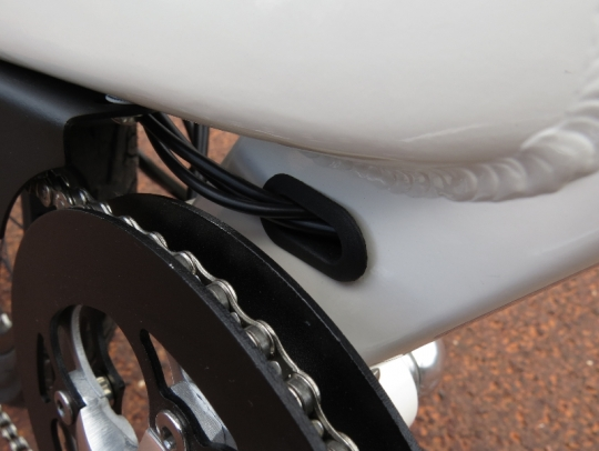 Near the cranks you can see the internal cable routing exiting the frame.