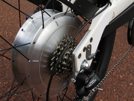 This is the 500 watt direct drive rear hub motor that provides 35 Nm of torque to help with acceleration and climbing.  It is a surprisingly quiet and smooth motor.  You can also see the pedal assist TMM4 torque sensor that is bolted to the rear dropout area of the frame.  The torque sensor measures how much power you are putting into the pedals (when using the pedal assist option) and then transmits that info to the bike computer system to provide you with the proportional amount of assist based on which assist level you have selected at the display (Economy, Standard, or High).