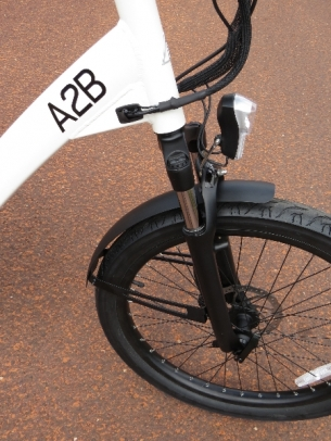 """A Suntour suspension fork takes some of the roughness out of the road with it's 2.5"""" of travel."""