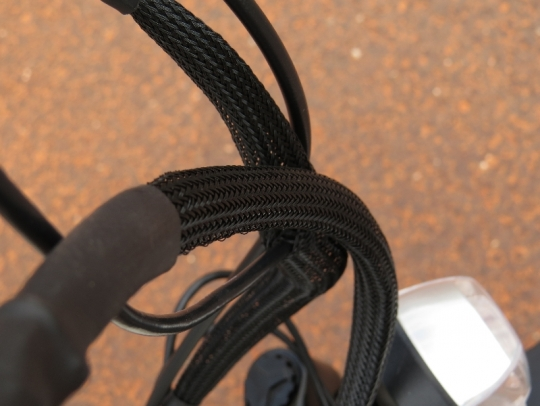 The details: most of the cables and shifter/brake housing are concealed in this braided wrap to keep the cable clutter to a minimum.