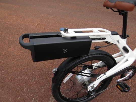 This is a view of the battery pack partially installed on the bike.  The bike connection chord has been detached from the battery.