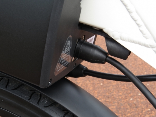 The connection to the charger and the bike connection (in the background) are magnetized like the charging cord on an Apple MacBook