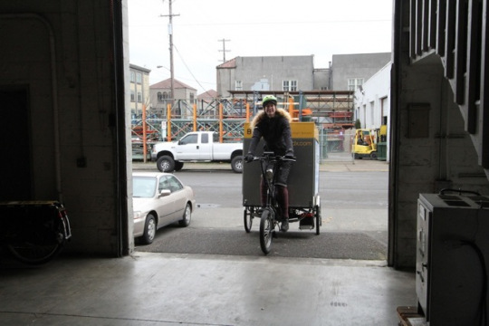 b-line-employee-riding-the-electric-delivery-trike
