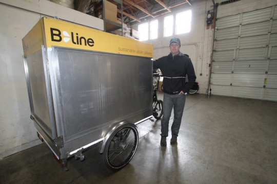 company-founder-owner-and-ceo-franklin-jones-poses-with-a-b-line-pdx-electric-assist-delivery-trike