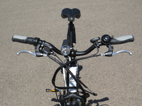 The front of the handlebars; note the LED front headlight.