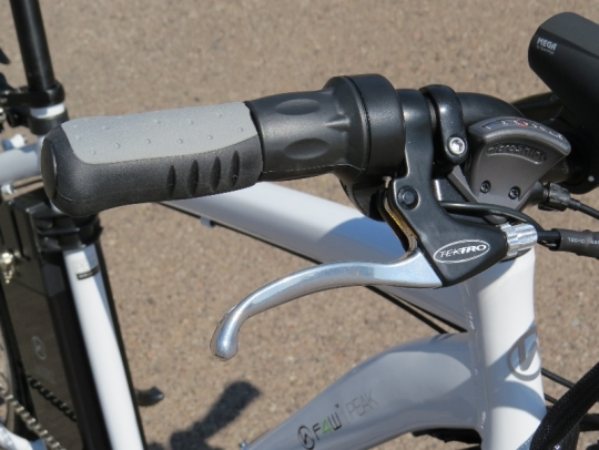 The right side of the handlebars: the rear brake lever, twist grip throttle, and the 8 speed rear derailleur shifter