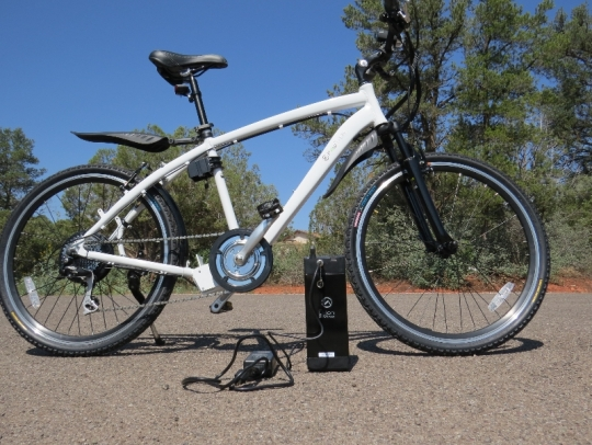 The battery can be charged on or off the bike with the included charger