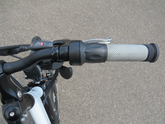 On the right side of the handlebar is the rear brake lever, twist grip throttle and the 8 speed rear derailleur shifter.