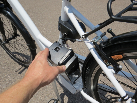 Removing the battery is easily done by unlocking it and rotating it to the left side of the bike.