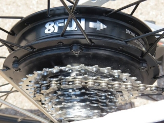 This is the 350 watt geared rear hub motor made by 8FUN (Bafang), a well known motor manufacturer in the e-bike world.