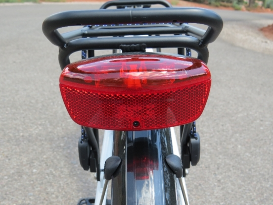 This is the rear LED light attached to the rear rack.  It is powered by its own batteries.