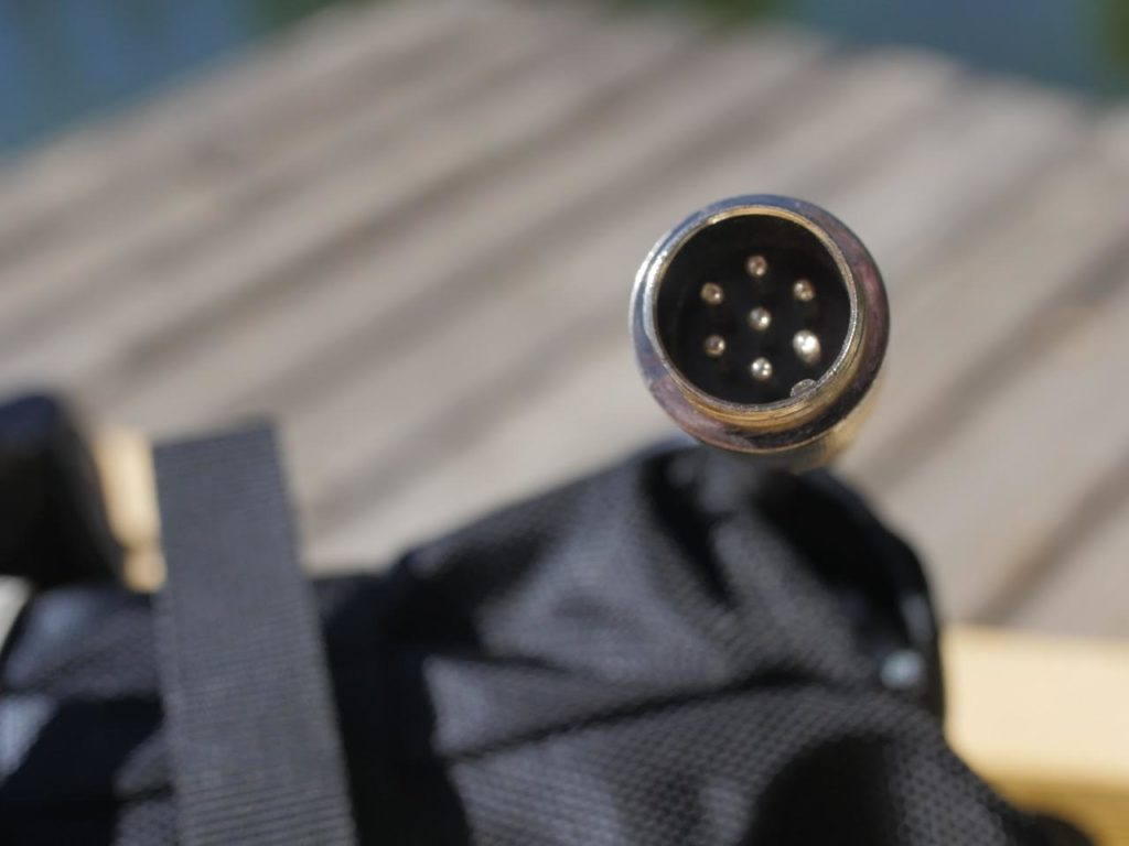 Batteries are connected via this 7 pin screw lock. As long as the small tab (visible below the pins on the inside of the ring in this image) is lined up properly with the female connection from the motor it connects quick, easy and secure.