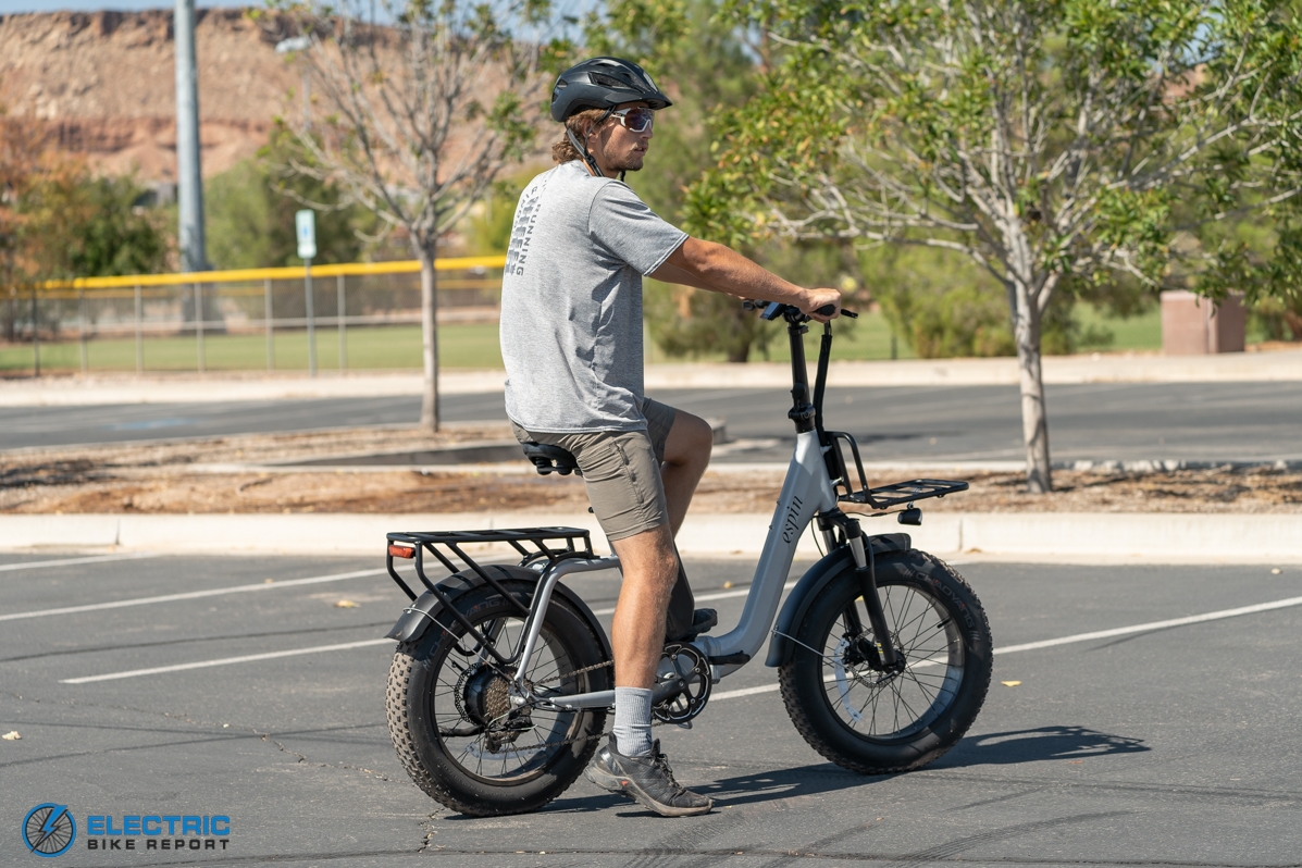 Espin Nesta Review Rider Standing On Bike